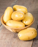 White potatoes fresh picked in wicker bowl Stock Photo