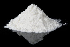 White powder on black reflective surface stock photos