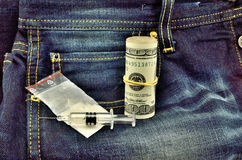 White powder dollars and syringe on jeans Stock Photos