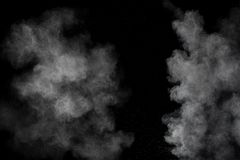 White powder explosion.Freeze motion of white dust particles on black background.  royalty free stock photo