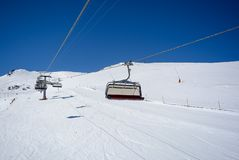 Chair Lift in the Alps with sunshine royalty free stock image