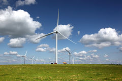 White Power Generating Wind Turbines Royalty Free Stock Photography