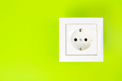 White power socket on green background Royalty Free Stock Photos