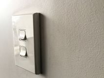 White power switch board on white wall Royalty Free Stock Image