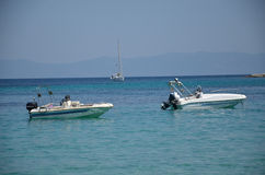 White Powerboats on Sea Royalty Free Stock Photos