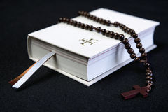 White prayer book and brown cross Royalty Free Stock Photos