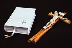 White prayer book and brown cross Stock Photos