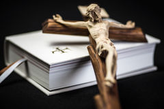 White prayer book and brown cross Royalty Free Stock Photography