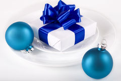 White present with blue ribbons table decoration Stock Photography