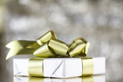 White present with gold ribbons Royalty Free Stock Photography