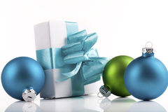 White present with ornaments. White present wrapped with sky blue ribbons and ornaments stock images