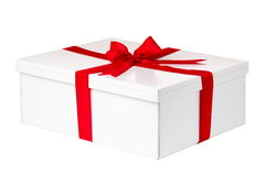 White present with red bow. Isolated on white Royalty Free Stock Photo