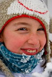 White preteen girl's face bundled up outside Stock Photos
