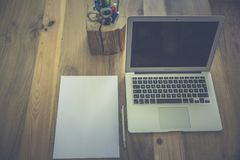 White Printer Paper Beside Macbook Air Royalty Free Stock Photography
