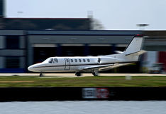 White private corporate jet taking off. From airport Stock Photo