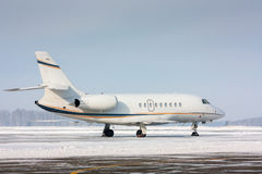 White private plane. In a cold winter airport stock image