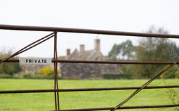 White private sign on farm gate Stock Photography