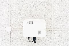 White projector hanging on the ceiling of conference room, projection multi-media equipment royalty free stock photos