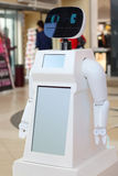 White promo robot with black face in big mall Royalty Free Stock Photo