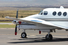 White prop plane parked Stock Photos