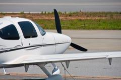 White Prop Plane Tied Down on Tarmac Royalty Free Stock Photos