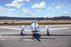 White Prop from Rear. A large white prop driven plane on tarmac from rear stock photos