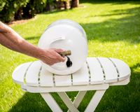Propane tank on a table with a man opening the valve stock photos