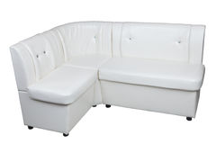 White pu leather modern corner sectional sofa for dining room. Royalty Free Stock Photography