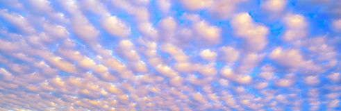 White puffy clouds against a blue sky Royalty Free Stock Photo