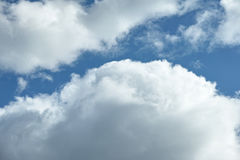 White puffy clouds against blue sky. Closeup of white puffy clouds against blue sky Royalty Free Stock Photo