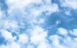 White puffy clouds Stock Photos