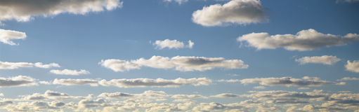 White puffy clouds and blue sky Stock Photo