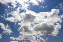 White Puffy Clouds on a Blue Sky 1 Stock Photos