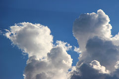 White Puffy Clouds on a Blue Sky 2 Stock Image