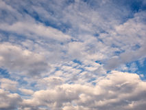White, puffy clouds in blue sky Stock Photography