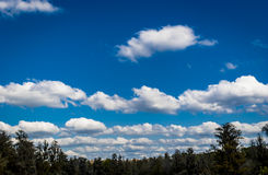 White Puffy Clouds Royalty Free Stock Photography