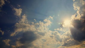 White puffy clouds move across a brilliant blue sky stock footage