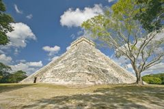 White puffy clouds over the Mayan Pyramid of Kukulkan (also known as El Castillo) and ruins at Chichen Itza, Yucatan Peninsula, Me Royalty Free Stock Photos