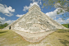 White puffy clouds over the Mayan Pyramid of Kukulkan (also known as El Castillo) and ruins at Chichen Itza, Yucatan Peninsula, Me Royalty Free Stock Images