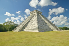 White puffy clouds over the Mayan Pyramid of Kukulkan (also known as El Castillo) and ruins at Chichen Itza, Yucatan Peninsula, Me Stock Images
