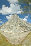 White puffy clouds over the Mayan Pyramid of Kukulkan (also known as El Castillo) and ruins at Chichen Itza, Yucatan Peninsula, Me Royalty Free Stock Photography