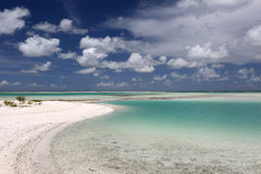 White fluffy clouds over turquoise lagoon water. Royalty Free Stock Image