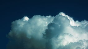 White puffy clouds timelapse on a blue sky background stock footage