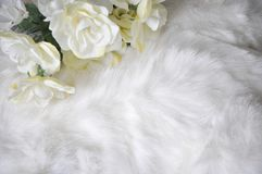 White Puffy Fabric Texture with Artificial Flower. White puffy fabric texture background for copy space decorated with artificial flower Royalty Free Stock Photos