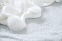White Puffy Scarf on Glitter Background. White puffy scarf on grey glitter background royalty free stock photo