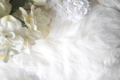 White Puffy Texture Background with flower. White puffy fabric texture background decorated with artificial flowers Stock Photo