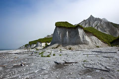 White pumice rocks at the seaside. Kuril Islands. Stock Images