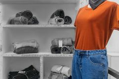 White Puppets model show fashion with orange shirt and women`s jean shorts in a fashion store.  royalty free stock photography