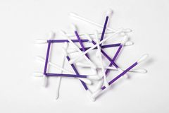White and purple cotton buds on white background. Hygiene concept ear plastic swab care clean closeup earwax group health heap isolated sanitary soft stick stock photo