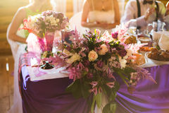 White and purple flowers, wedding accessories, wedding preparation, decorated wedding table Royalty Free Stock Photos